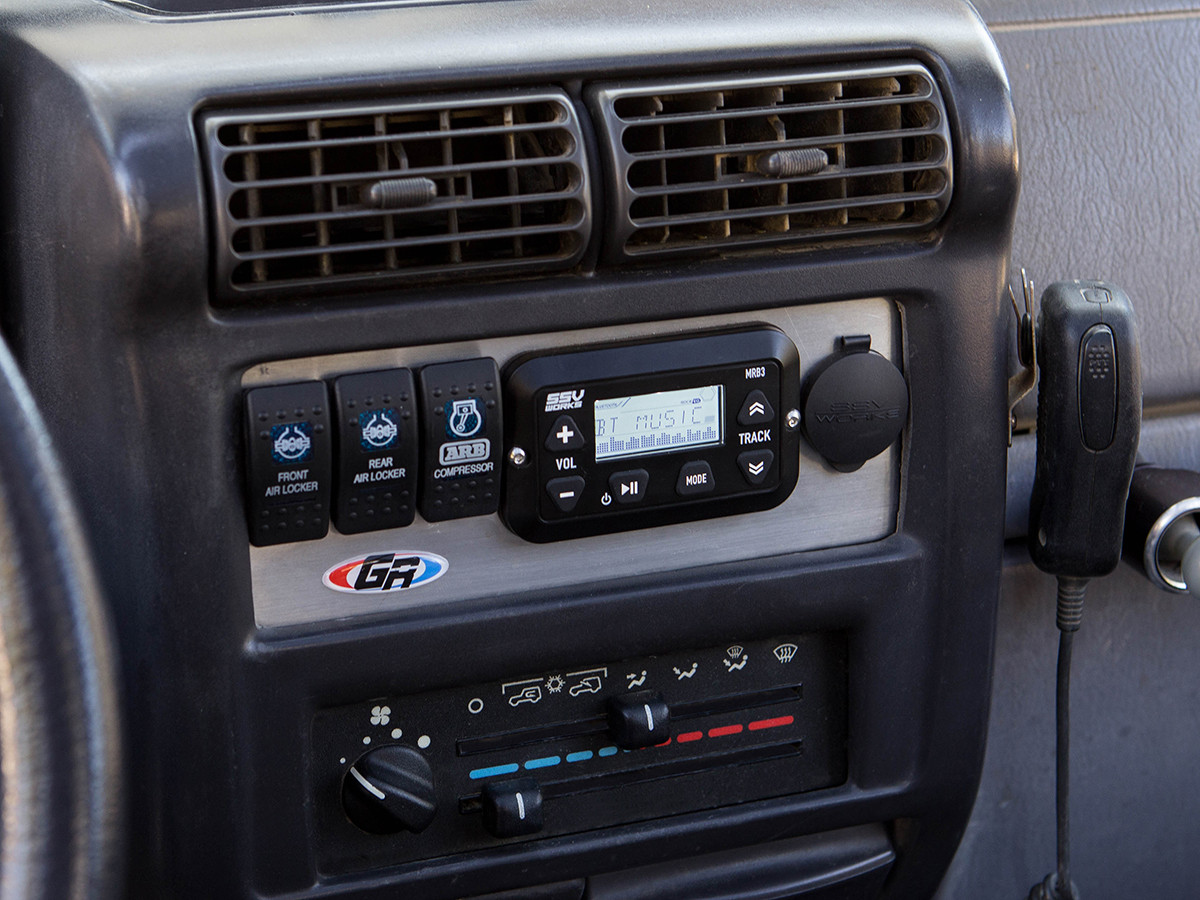 Shown Installed in a Jeep Wrangler TJ using the GenRight aluminum radio plate