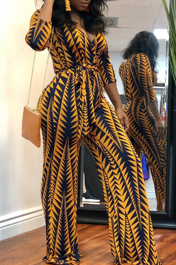 29784a308779 BrytCouture One-piece African Floral Printed Yellow Blending Jumpsuit