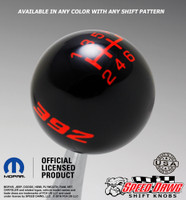 Black shift knob with Go Mango Orange graphics