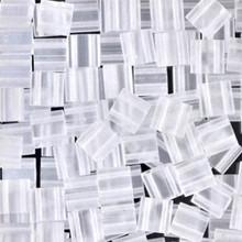 Miyuki Tila Beads, 5x5x1.9mm, 2-parallel 0.8mm holes, SKU 501000.TL-0131F, matte crystal, 9.5 gram tube, apprx  104 beads, (1 tube)