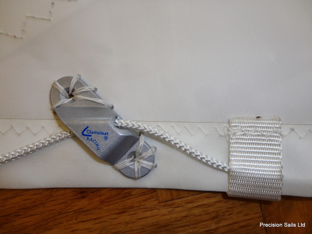Velcro tab and cleats are two ways of adjusting the Leech and Foot lines of a sail