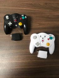 Pair Of Black And White GameCube Wireless Controllers - EE742841