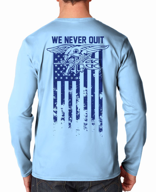 Back of Shirt - 100% Polyester, SPF 45+, Anti- Snag, Superior moisture wicking, Stain Release, Oder Resistant. Light Blue