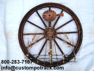 quail creek copper designed this beautiful wooden wheel with a windmill, features a variety of different molded metal and custom built wind mill