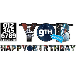 The Force will be with you on your big day with a Star Wars Birthday Banner Kit. Letter cutouts feature images of Star Wars characters, including Darth Vader, Luke Skywalker, and Yoda. The center is a star-filled round cutout that can be customized with the age of your little Jedi! Easily hang it by the strings for an out-of-this-galaxy decoration at your Star Wars party. Star Wars Birthday Banner Kit includes:  Banner, 10 1/2ft wide x 10in tall 24 numbers and characters 2 each of 0-9 1 each of TH, RD, ND, and ST 5 pieces of double-sided tape