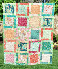 """Block Talk made from 40 precut 10"""" squares and an accent.  Lap size."""