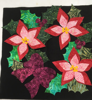 Lacy Poinsettia Kit showing actual batik fabrics.