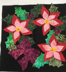 Lacy Poinsettia Kit showing actual batik fabrics.