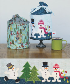 Snow Follies Bundle Includes Pattern, one Spring and one set of laser cut applique shapes. Tiny Black Buttons for snowman eyes and buttons included. Does not include fabric for Body of pop up or stabilizer.