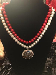 DOUBLE STRAND OF DELTA PEARLS