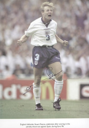 England defender Stuart Pearce celebrates after scoring in the penalty shoot-out against Spain, during EURO 96.