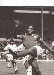 Portuguese striker Eusebio in action for Benfica V AC Milan in the 1963 European Cup Final.