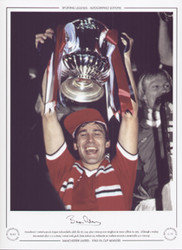 Manchester United captain Bryan Robson holds aloft the FA Cup, after his sides victory over Brighton & Hove Albion in 1983. Although a replay was needed after a 2-2 draw, United with goals from Robson(2), Whiteside & Muhren secured a memorable 4-0 victory.