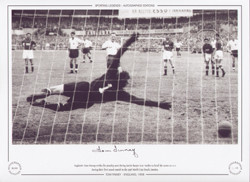 England's Tom Finney strikes his penalty post diving Soviet keeper Lev Yashin to level the scores at 2-2 during their first round match in the 1958 World Cup Finals.