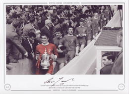 Liverpool captain Ron Yeats clutches the FA Cup as he leads his team down the Wembley steps after Liverpool's 2-1 victory over Leeds United in the 1965 Final.