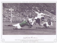 Manchester City keeper Bert Trautmann dives at the feet of Birmingham City's Peter Murphy during the 1956 FA Cup Final.