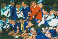 Superb hand signed Photograph showing the Everton players celebrating after winning the European Cup Winners Cup 15 May 1985