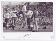 Tottenham Hotspur captain Dave Mackay leaps through the air to join in the celebrations as Alan Mullery had given Spurs the lead against Leeds United, 1966.