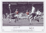 Manchester United's Lou Macari and Jimmy Greenhoff join forces to score the winning goal in the 1977 FA Cup Final. The goal was a result of a shot from Macari, which was deflected off Greenhoff's chest and over Liverpool keeper Ray Clemence.
