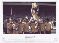 Arsenal captain Frank McLintock holds aloft the FA Cup as he is chaired by teammates after victory in the 1971 FA Cup Final
