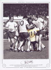 Arsenal players surround Charlie George who has just scored the winning goal in the 1971 FA Cup Final, a stunning effort from outside the box.