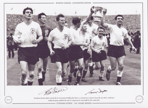 Tottenham Hotspur players parade the FA Cup around Wembley after their 2-0 victory over Leicester City in the 1961 FA Cup Final.