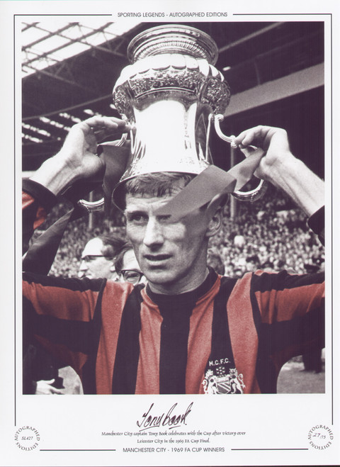 Manchester City captain Tony Book celebrates with the cup after victory over Leicester in the 1969 FA Cup Final.
