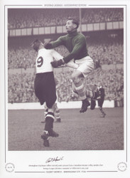 Birmingham City keeper Gilbert Merrick under pressure from a Tottenham Hotspur player, punches clear during a League Division 2 game at White Hart Lane in 1946.