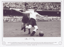 England's Tom Finney holds off Chile's Roldan during a World Cup clash on the 26th of June 1950 in rio de Janeiro's famous Maracana Stadium.