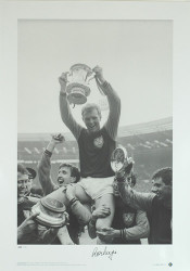 Bobby Moore celebrates with his team mates, after West Ham win the 1964 FA Cup Final at Wembley Stadium. Signed by Ronnie Boyce.