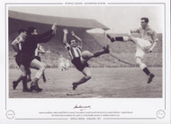 Argentina goalkeeper Miguel Rugilo blocks an attempt from England's Harold Hassall with the aid of a couple of defenders. England defeated their South American opponents 2-1, in this friendly encounter held at Wembley in 1951.