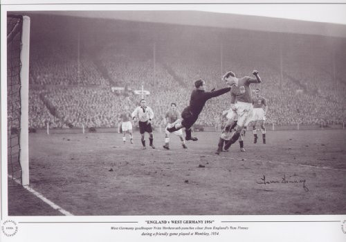 West Germany keeper Fritz Herkenrath punches clear from England's Tom Finney during a friendly game played at Wembley, 1954.