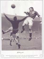 England's Harold Hassall heads the ball back across the goal as Argentina's keeper Miguel Rugilo flaps hopelessly. England defeated their South American opponents by 2 goals to 1 in this friendly encounter at Wembley stadium in 1951.