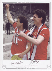Manchester United's Arthur Albiston and Frank Stapleton applaud the fans after United denied Everton a famous treble, by beating them 1-0 in the 1985 FA Cup Final.