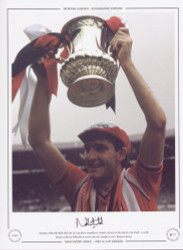 Norman Whiteside holds aloft the FA Cup after Manchester United's victory in the 1985 FA Cup Final. A 110th minute strike by Whiteside in extra time was enough to seal a famous victory.