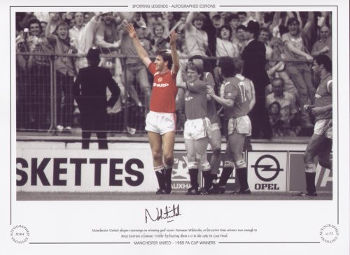 Manchester United players converge on winning goal scorer Norman Whiteside, as his extra time winner was enough to deny Everton a famous treble by beating them 1-0 in the 1985 Cup Final.