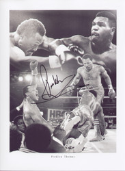 Pinklon Thomas Former WBC/IBO World Heavyweight Champion  Superb signed montage showing some of the iconic moments from his fights. Signed at a private signing held in Florida, June 2010.