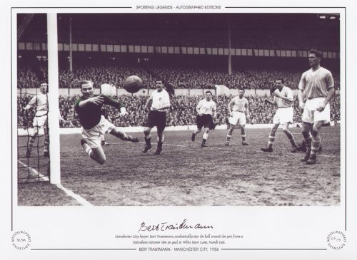 Manchester City goalkeeper Bert Trautmann, acrobatically tips the ball around the post from a Tottenham Hotspur shot on goal at White Hart Lane, March 1956.