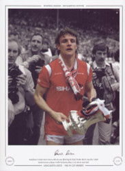 Manchester United's Kevin Moran, who was sent off during the Final, clutches the FA Cup after United denied Everton a famous 'Treble' by beating them 1-0 in 1985 FA Cup Final.