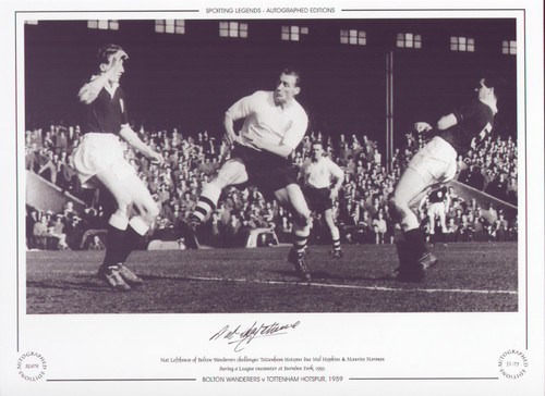 Nat Lofthouse of Bolton Wanderers challenges Tottenham Hotspur duo Mel Hopkins & Maurice Norman during a League encounter at Burnden Park, 1959.  Great action picture featuring one of the true greats of English football.