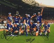 The victorious Everton team celebrate with the FA Cup after their 2-0 victory over Watford in the 1984 final.