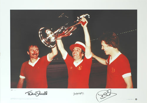 Stunning hand signed specially commissioned Limited Edition picture of Liverpool Legends Tommy Smith, Ian Callaghan and Phil Neal celebrating the first of Liverpool's European Cups in Rome in 1977. This iconic picture has been signed by Smith, Callaghan & Neal. Liverpool were the eventual winners beating Borussia Moenchengladbach 3-1.