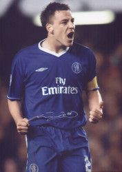 "Chelsea legend and Captain John Terry shows his delight after scoring against Barcelona in the Champions League. Superb signed 16"" x 12"" photograph."