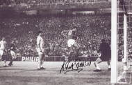 Manchester United's David Sadler scores against Real Madrid in the 1968 European Cup Semi Final.