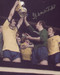 """Frank McLintock proudly lifts the FA Cup. Arsenal overcame Liverpool in the Final on their way to achieving a league and cup double in the 1970-71 season. The photograph is 12"""" x 8"""" (305mm x 205mm) and has been signed in silver sharpie marker by Frank McLintock."""