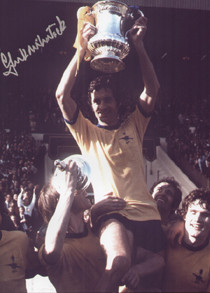 "Frank McLintock is chaired after Arsenal's 1971 FA Cup Final triumph over Liverpool in 1971. The photograph is 12"" x 8"" (305mm x 205mm) and has been signed by Frank McLintock."