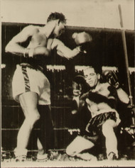 On offer is an original radio/wire photograph showing Sugar Ray Robinson following through with the knockout punch against Carl Bodo Olson in the fourth round of their World Middleweight title fight in Los Angeles 18 May 1956.