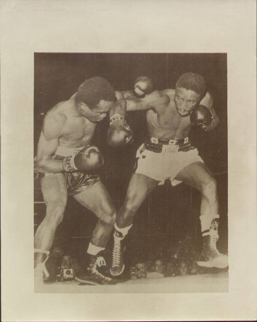 On offer is an original radio/wire photograph showing Davey Moore in action against Hogan 'Kid' Bassey. Moore stopped Hogan in the 11th round of their World Featherweight tittle bout held in Los Angeles on 19 August 1959.