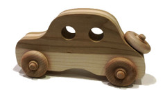 "Need a small gift that is beautiful in appearance and fun to play with too? We have an assortment of inlaid vehicles a putt-putt car, mini bus, and old fashioned sedan, all crafted in mixed hardwood designs, including maple and walnut, and cherry and maple. The cars are approximately  8"" long x 4"" high."