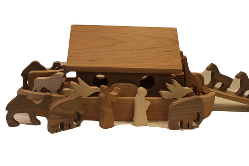 """Noah's Ark is crafted of solid cherry and includes Noah and his wife, nine pairs of wooden animals (doves, elephants, giraffes, camels, bears, cows, lions, pigs, and horses) for a total of eighteen animals, and a ramp to help them climb aboard. The animals are in cherry, birch,walnut and oak. The ark is a unique keepsake gift for a new baby, or toddler's birthday. The ark is 19"""" long x 9"""" high x 8"""" wide."""